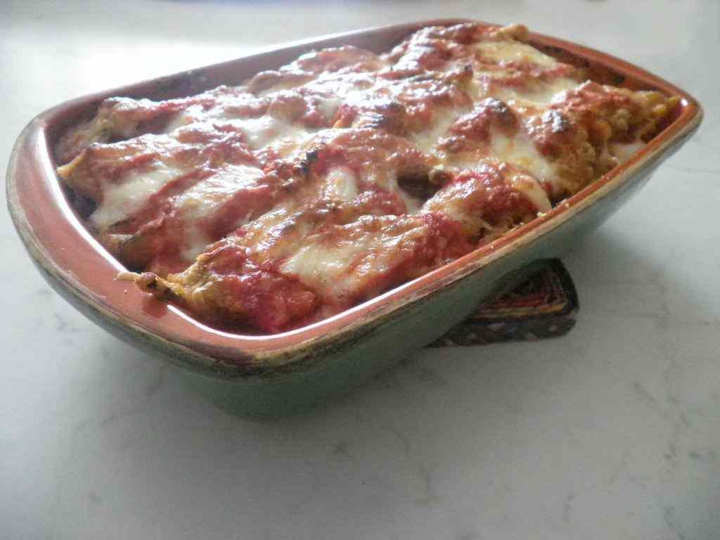Ricetta: Parmigiana con fiori di zucca pastellati e salame