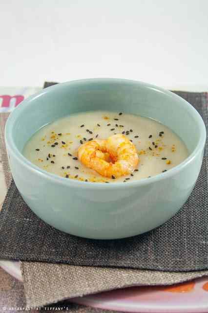 Ricetta: Zuppa di topinambur con gamberoni saltati al curry e brandy