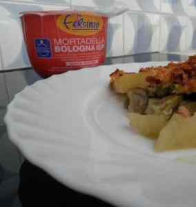 Ricetta: Sformato di patate piselli e carciofi con mortadella in crosta